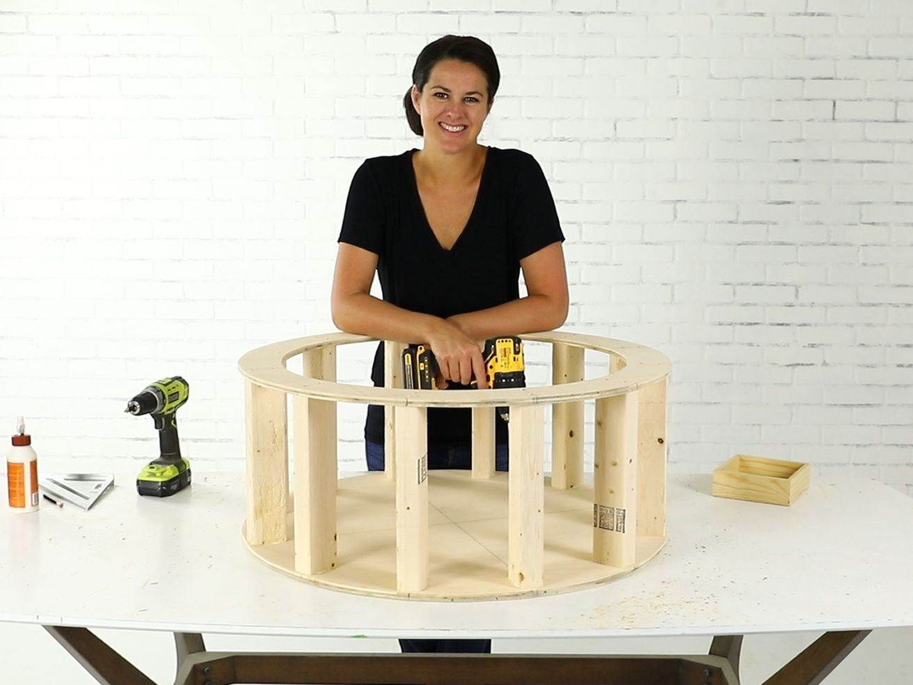 Jenn Largesse builds a round tufted ottoman with storage.