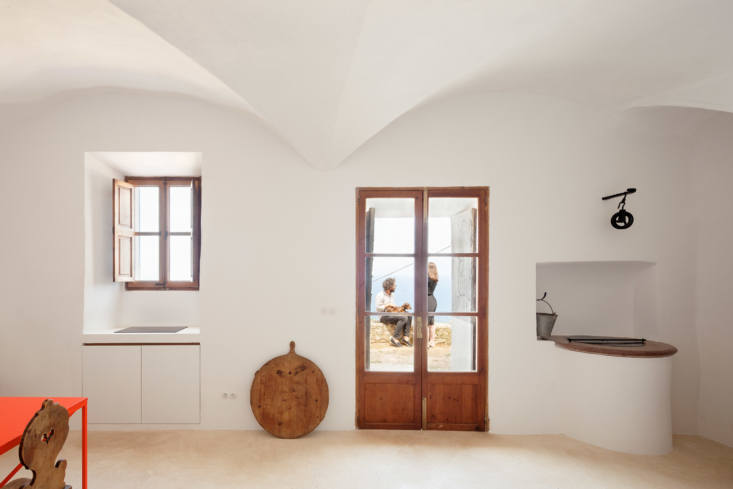 Kitchen and Front Door of Can Rei in Mallorca by Isla Works