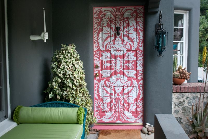 Front door stenciled with a damask pattern.
