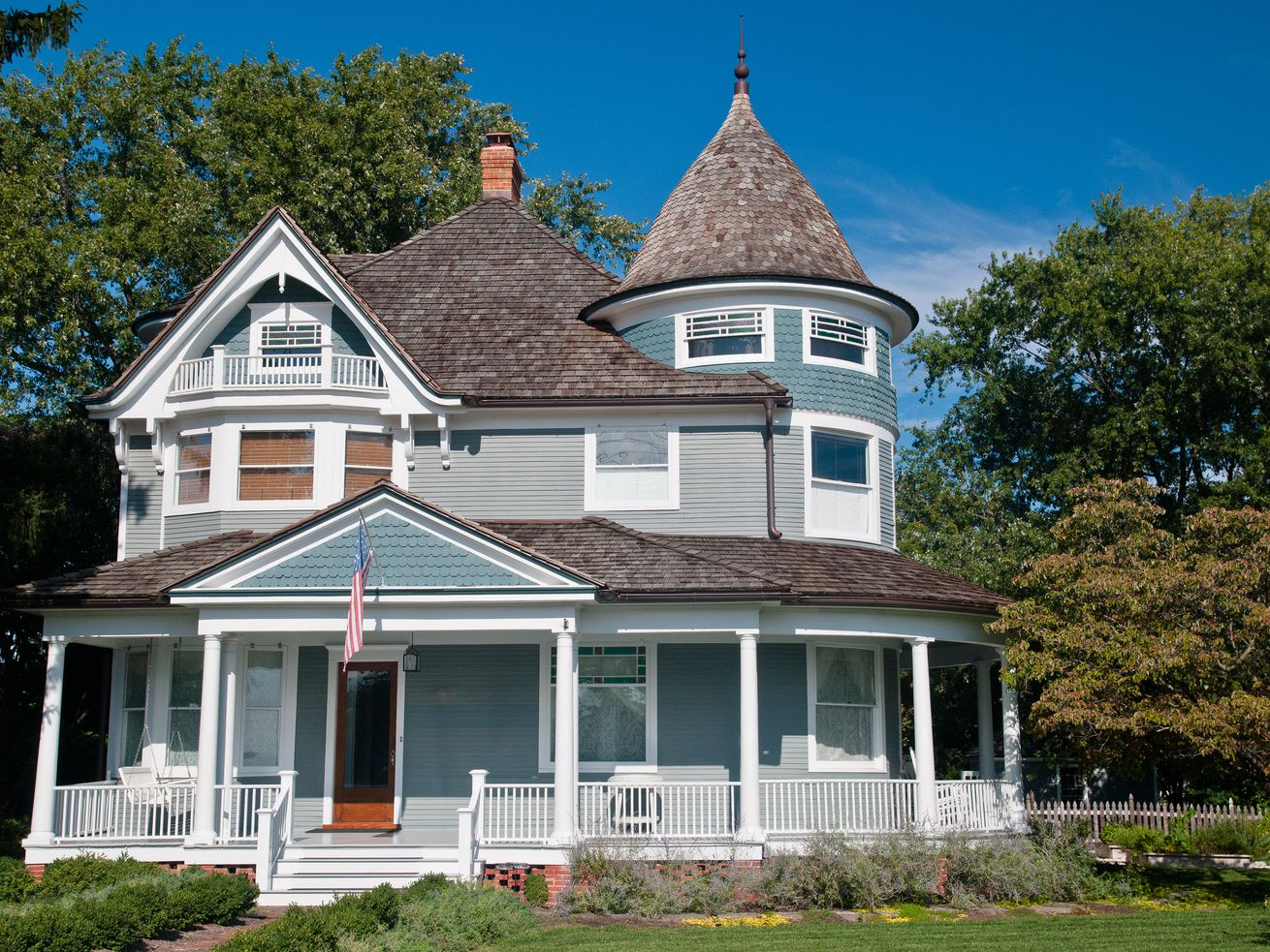 Beautiful gray traditional victorian house.