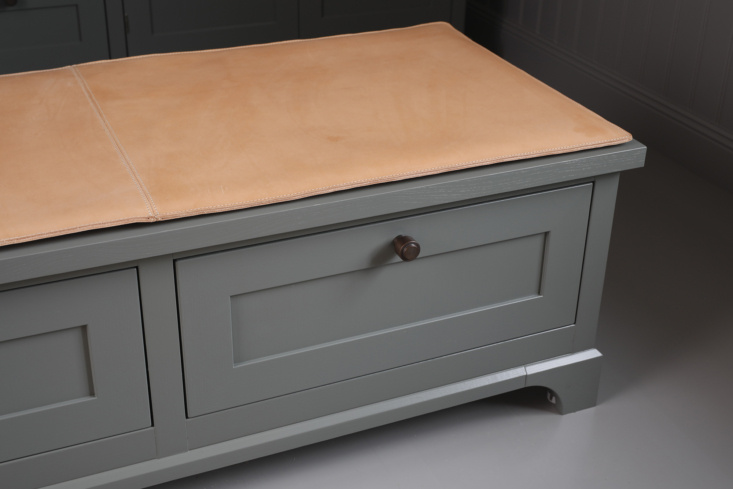 Leather-topped storage bench in a dressing room by Kvanum of Sweden.