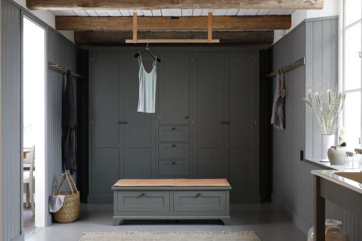 Wood paneled dressing room with built-ins by Kvanum of Sweden.