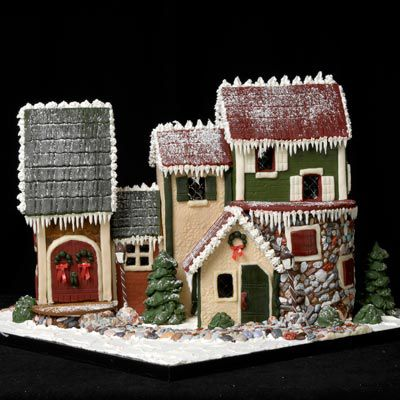 This cool gingerbread has powdered sugar and icicles made of icing on the side of the roof.