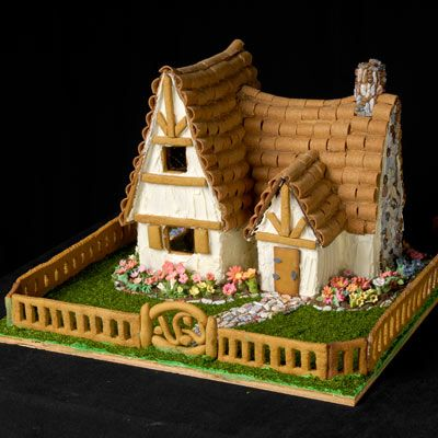 This amazing gingerbread house is a cottage complete with a decorative gingerbread fence.