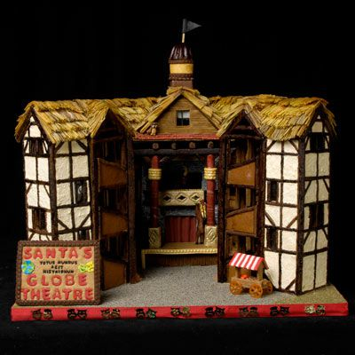 """An amazing gingerbread house in the shape of Shakespeare's globe theatre with a sign in front of it that says """"Santa's globe theatre."""""""