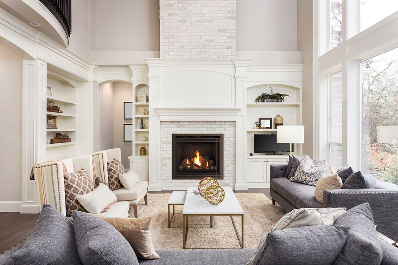An insert gas fireplace in a bright, modern living room.