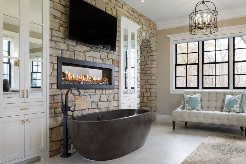 See through gas fireplace in bathroom.